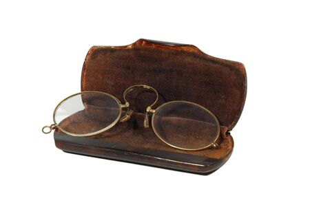 antique vintage oval pince-nez spectacles and tortoiseshell case, isolated on white