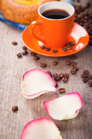 cup fool of coffee with cake on wooden background