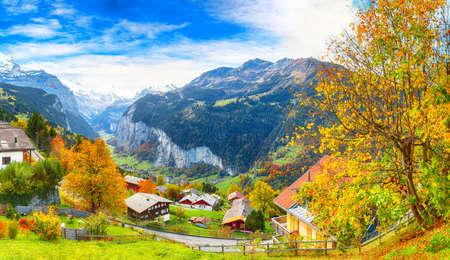 Photo for Stunning autumn view of picturesque alpine village Wengen with Jungfrau Mountain and Lauterbrunnen Valley on background. Location: Wengen village, Berner Oberland, Switzerland, Europe. - Royalty Free Image