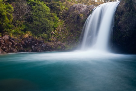 Water from volcano Mt Ruapehu forms Tawhai Falls in Tongariro National Park, New Zealand