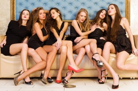Group portrait of models in black dresses