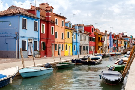 The island in the lagoon near Venice. Famous tourist attraction. Famous for its colorful houses and lace.