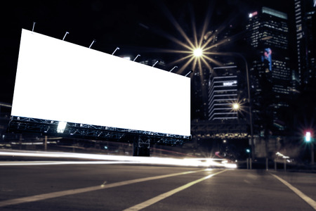 blank billboard at night time for advertisement city street night light , colored filter.