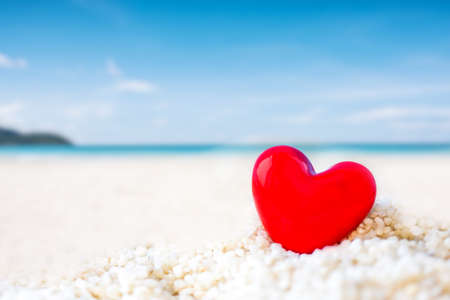 Photo pour red Heart shape on white sand beach ,Image for love valentine day or summer vacation concept - image libre de droit