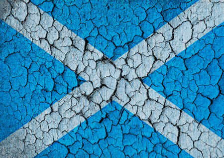 Scottish flag on a cracked grunge background