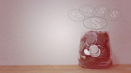 Money in the glass , financial concept , Vintage tone soft focus old walls background