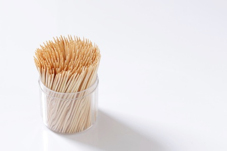 Toothpicks in a box on white background