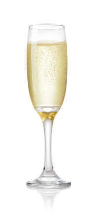 Foto de single glass of champagne with air bubbles isolated on white background - Imagen libre de derechos