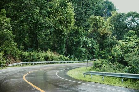 Foto für Foggy road in the forest ,Beautiful nature trail (Picture put grain) - Lizenzfreies Bild