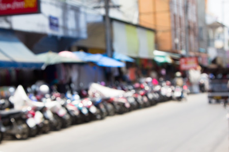 Blur image of motocycle park in big market,Chiangmai Thailand with bokeh