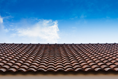 red tile roof blue sky