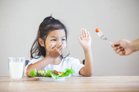 Foto de Asian child does not like to eat vegetables and refuse to eat healthy vegetables - Imagen libre de derechos