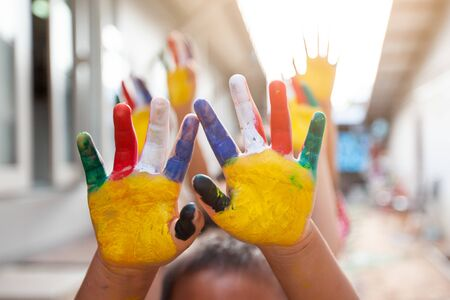 Photo pour Cute asian child boy and girl with painted hands playing together with fun and happiness - image libre de droit