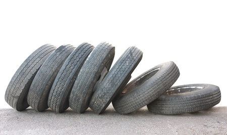 A row of old obsolete tires isolated on white