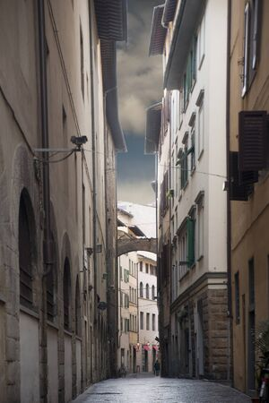 Narrow street in Florence, Italy, on a cloudy rainy day