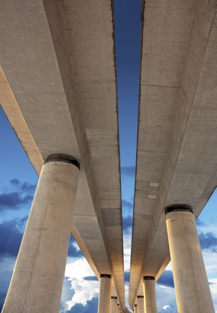 Elevated road on columns on blue sky