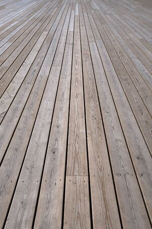 background of light knotted wooden floor boards