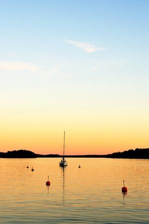 yacht in stockholm archipelago in evening