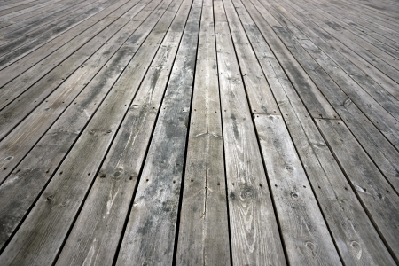 Background with weathered floor of knotted wood
