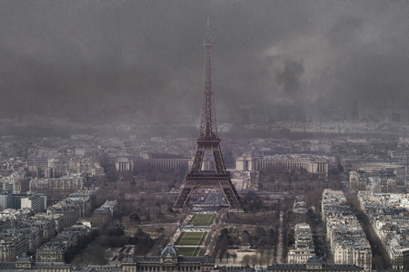 aerial view of eiffel tower on stormy rainy day in autumn