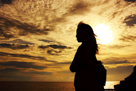 silhouette of woman standing to thinking of some things with hope
