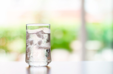 The glass of Cool fresh drink with ice cube on the  table