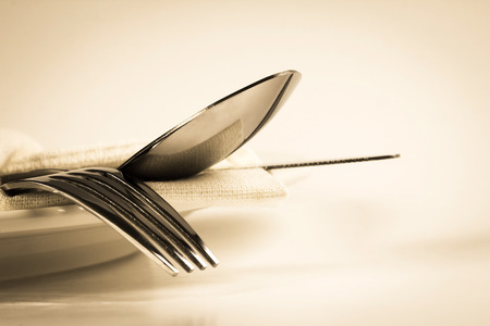 Photo for vintage color of close up dinning the silverware fork , spoon and knife with dish on white background and text space - Royalty Free Image