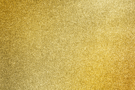 close up the golden glitter texture for glamour holiday background