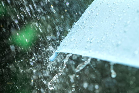 selective focus for close up a part of the umbrella which has Rain drops falling , shallow DOFの写真素材