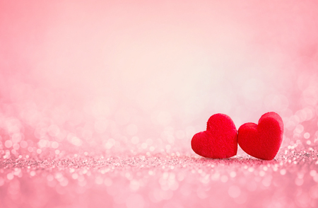 Foto per The red Heart shapes on abstract light glitter background in love concept for valentines day with sweet and romantic moment - Immagine Royalty Free