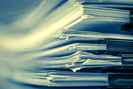 Foto de extreamly close up  stacking of office working document with paper clip folder, retro color tone - Imagen libre de derechos
