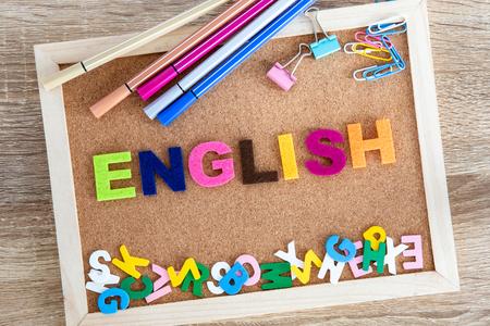 Foto de colorful ENGLISH word alphabet on pin board background ,English language learning concept - Imagen libre de derechos