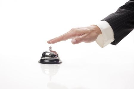 Foto für business man hand ringing the bell to call  - Lizenzfreies Bild