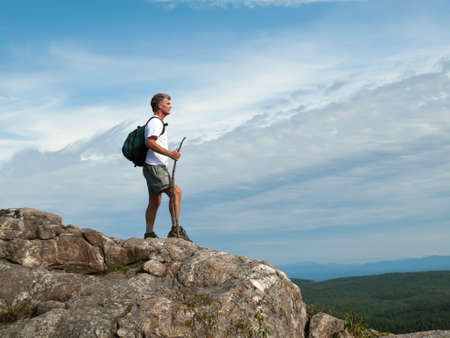 Mature Adult Man standing on mountaintop