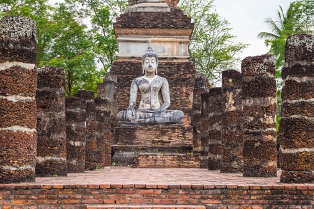 Buddha Statue in Wat Mahathat Temple in Sukhothai Historical park at sunrise Thailand