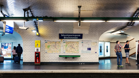 PARIS, FRANCE - MAY 17, 2014: Montparnasse Metro Station. The Paris Metro is a rapid transit system in the Metropolitan Area. It is mostly underground (214 kilometres) and has 303 stations.