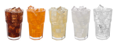 Foto de Glasses with sweet drinks with ice cubes isolated on white - Imagen libre de derechos