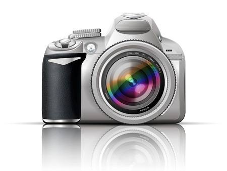 gray slr camera on a white background with the reflection of the