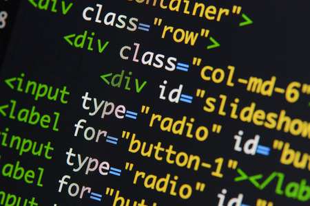 Foto de Real Html code developing screen. Programing workflow abstract algorithm concept. Lines of Html code visible. - Imagen libre de derechos