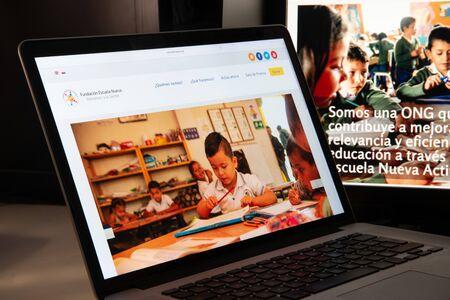 Milan, Italy - August 15, 2018: Escuela Nueva NGO website homepage. Escuela Nueva logo visible.