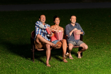three friends in exterior cinema