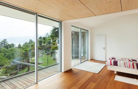 Foto de Interior, modern house, bedroom with balcony - Imagen libre de derechos