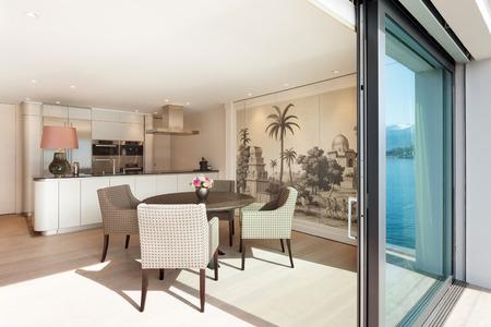 Interior beautiful apartment, elegant dining room view from veranda