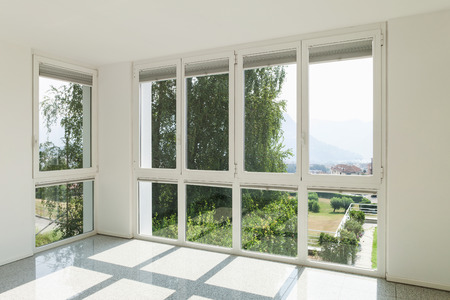 Foto de Architecture, interior of a modern house, wide room with windows - Imagen libre de derechos