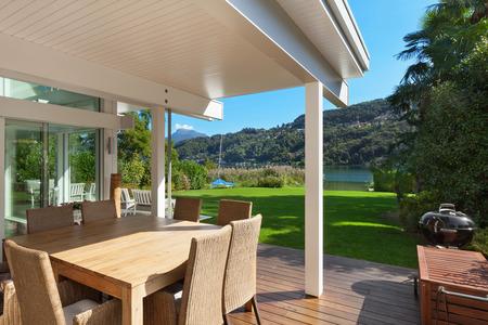 modern house, beautiful veranda with furniture