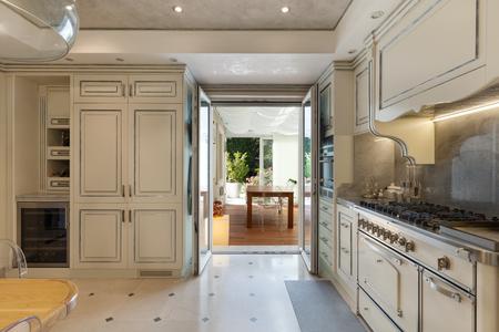 Photo pour domestic kitchen in classic style, veranda view - image libre de droit