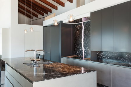 Photo for Interior of a loft, kitchen with marble counter top, modern design - Royalty Free Image