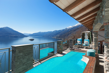 Photo for Terrace with pool and lake view in a luxury house - Royalty Free Image