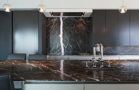 Photo pour Interior of a loft, kitchen with marble counter top, modern design - image libre de droit