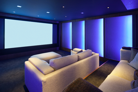 Photo for Home theater, luxury interior, comfortable divan and big screen - Royalty Free Image